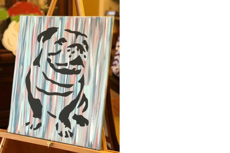 Painting of a bulldog on a blue/red/white canvas